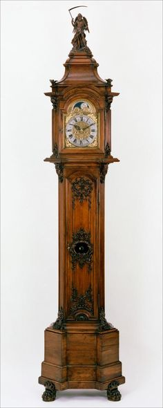 Grandfather Clocks // the grim reaper on top is a nice touch
