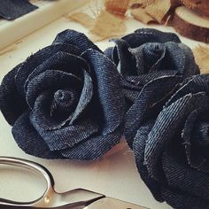 Denim roses, cut petals, cover with Mod Podge and curl to shape. When dry make roses.