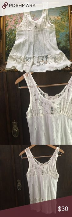 Free People white top wonderfulness It's amazing! Free People lace with linen, and an open back! You can wear this with shorts, long skirts, short skirts, beach, pool, even jeans! Just lovely! It's size 6, but will fit an xsmall, small. Possibly a medium. Free People Tops