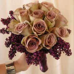 Lilacs would be out of season and the purple would have to come from something else, but I think this is beautiful