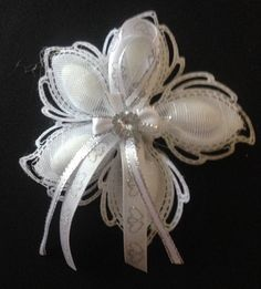 White and silver Jordan almond wedding flower favors - made to order.  *Additional shipping costs may be added on larger orders and rush orders.  Embellishments and ribbon subject to change due to availability.