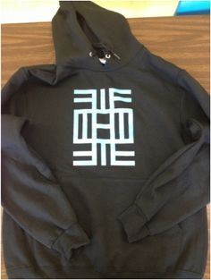 Breaking the Chain Sweatshirt - the adinkra symbol on the front means education.  $25