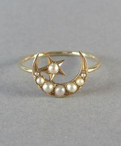 Show someone she's the center of your universe with an antique moon-and-star ring. #etsyjewelry