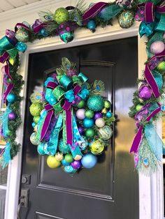 Peacock Themed Christmas Wreath - spark a conversation with this stunning teal and purple Christmas wreath!