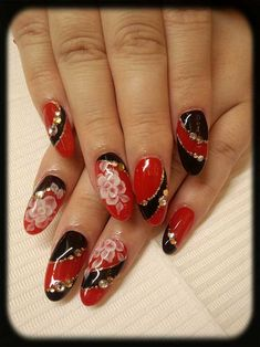 Could do this using our new RED and JET BLACK nail art powders with the Dark Gold Nano Glitter.  Think they would look fantastic!    www.thenailartist.co.uk