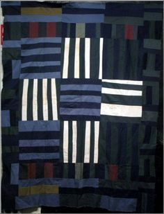 """nine patch medallion vintage quilt. 68 X 84, c. 1940-50.  Made from workmen's uniforms. """"A simple composition that has a powerful visual impact, like a contemporary painting that could be hung on a gallery wall""""."""