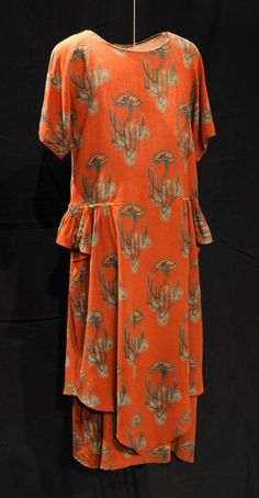 Orange crêpe dress from 1925 with a green and blue tree print, at the Bowes Museum. Via Fashion at Bowes on Twitter.