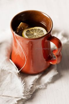 Tea with lemon in orange mug. :)