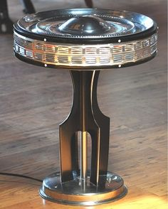 Space Needle inspired recyled art: Air Vent Hubcap Lamp by Pat Tassoni