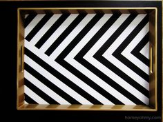 Update a coffee table tray using painters tape and spray paint. | Homey Oh My!