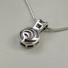 Sterling silver Rennie Mackintosh style rose pendant by Kit Heath, with chain necklace.