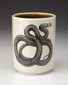 Add some mystery (and luck) to your morning coffee with this coffee cup to by Laura Zindel