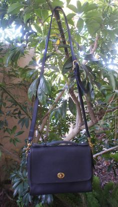 the vintage Black Coach court bag