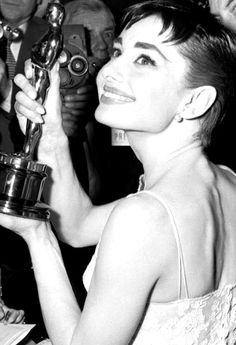 Audrey Hepburn shows her Best Actress Academy Award for her performance in Roman Holiday at the Oscars, 1954