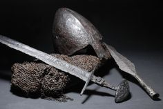 Viking sword, Piast dynasty helmet and spear head found in Lednica Lake (Poland). c. 9th century AD