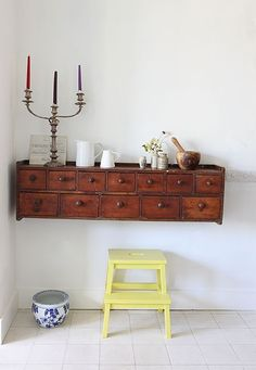 small set of shelves or drawers screwed to a hall wall