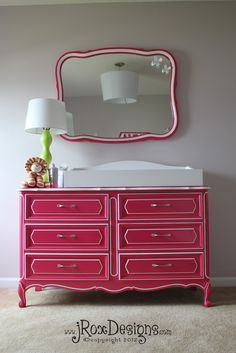 Emily Shares: Dresser = Changing Table >>>loving the  white details against the pink and also the size and shape of the mirror ! I think that this would be a nice size for your dresser/changing table, Meg!