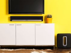 Notice Sonos Bar - Will want this instead of surround sound speakers...goes under TV....can sit on stand and TV can be mounted.