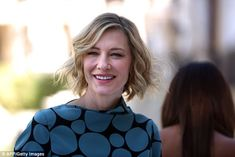 Understated make-up: She styled her cropped blonde hair in corkscrew curls and complemente...