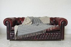 Loophouse throws are made in the UK using lambswool. Wool Blanket, Wool Rug, Chesterfield Chair, Interior Accessories, Handmade Rugs, Portfolio Design, Contemporary Design, Blankets, Accent Chairs