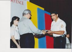 #santhanaram receiving the individual outstanding suggester award - MINDEF (2000)