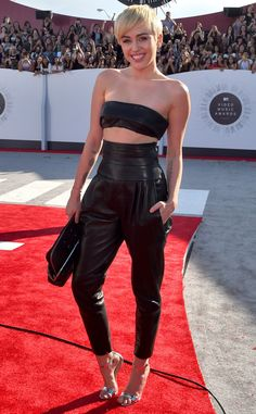 Miley Cyrus from 2014 MTV Video Music Awards Red Carpet Arrivals  Former Disney darling looked covered up compared to her last year's look.