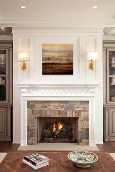 Traditional fireplace with gorgeous millwork and stone