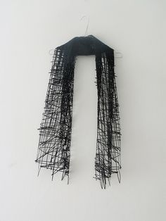 """""""Elvira 't Hart's collection aims to translate 2D sketches to 3D garments...Hart actually makes her sketches the pattern. Using laser cuts, one can see how lines abruptly stop, outlines are inconsistent much like that of hand generated sketches, spaces are empty, and one automatically fills in this space with their imagination."""""""