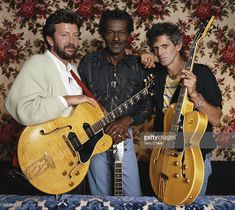Guitarists Eric Clapton, Chuck Berry and Keith Richards at Chuck Berry's Los Angeles home during the filming of Taylor Hackford's documentary 'Hail! Hail ! Rock n Roll', 1986.
