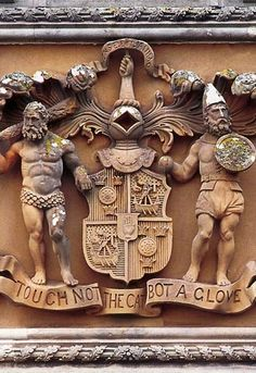Heraldry. 'Touch not the cat bot a glove' is the Macpherson family motto.  Above is 'Ense et Animo', which means in sword and in spirit & is the family motto of the Grants.  Ballindalloch Castle