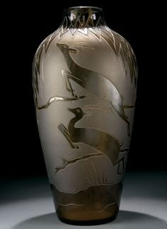 A FRENCH ART DECO CAMEO GLASS FLOOR VASE circa 1925, with cut design of leaping gazelles on an acid finish ground.