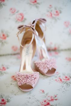 Beautiful light pink heels...perfect for a wedding. They look like they have little rosettes on them!
