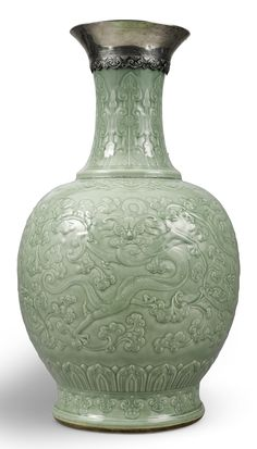 Exceptionally Large and Rare Carved Celadon-Glazed 'Dragon' Vase. Qing Dynasty, Qianlong Period. The crisp celadon glaze reflects the Qing emperors' admiration of Song period Longquan wares. Its highly unusual carved motif appears to be an 18th century innovation. Striking in its impressive size and rarity, this vase simultaneously celebrates and reinterprets porcelain traditions.