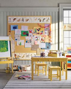 More is more when it comes to kids' creativity: They're prolific artists -- and they work on a larger scale. (They would never settle for 8 1/2-by-11-inch paper when 11-by-17-inch is on offer.) In the playroom at Martha's, a double-height bulletin board made from Homasote -- an affordable fiberboard used for soundproofing -- covered with fabric provides ample space for art by her grandchildren, Jude and Truman, as well as by visiting friends.