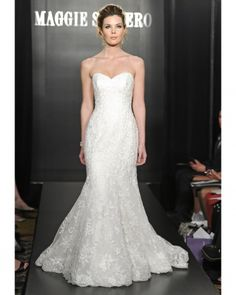 Maggie Sottero, so pretty but very similar to the one you tried on. alot of the lace have shoulder straps.