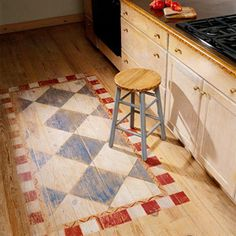 {BHG} Instead of painting the entire floor, paint an area rug in a prominent place to add interest. Use a light hand to let the beauty and grain of the wood show through.      On this kitchen floor, the rug design was applied to bare wood using acrylic paint and taped-off sections of checks and blocks. Light sanding after the paint dries creates the worn, faded appearance.