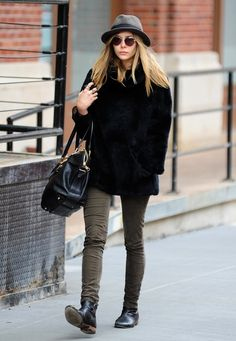 Elizabeth Olsen: fur coat, hat, olive green skinnies, chelsea boots.