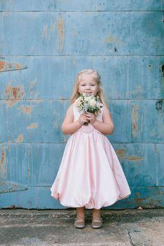 Pink flower girl dress  Photography: Sweet Little Photographs - sweetlittlephotographs.com  Read More: http://www.stylemepretty.com/2014/07/30/glitter-gold-diy-wedding/