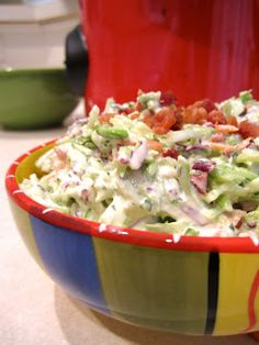 Low-Carb Side: Bacon Ranch Broccoli Slaw, 2/3 cup fat-free sour cream,  1 1/2 tablespoons dry ranch dressing,  One 12-oz. bag dry broccoli cole slaw,  1/4 cup precooked real crumbled bacon