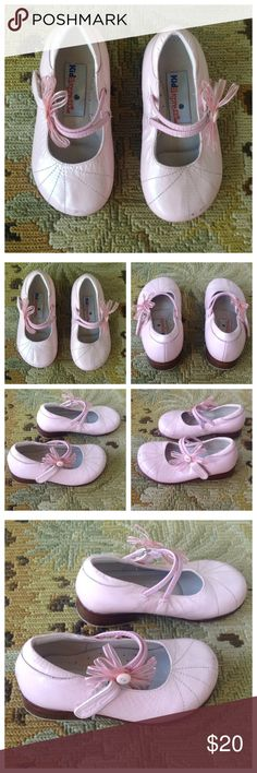 Kid Express Pink Leather Dress Up Shoes 6 Kid Express. Super cute pink genuine leather dress up shoes. Cute bow with button on side. Velcro closure. Could use a shining but otherwise in excellent condition. Toddler size 6. Kid Express Shoes Wedges