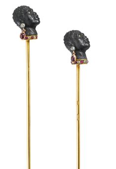 A pair of Fabergé gem-set carved hardstone hat pins, workmaster Alfred Thielemann, St. Petersburg, circa 1895.   Estimate  12,000—18,000  USD.   LOT SOLD.  15,000 USD. 08/04/14.   ||| sotheby's n09134lot7bjn9en