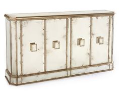 "42""Hx74""Wx18""D Juno Foxed Mirror 4 Door Credenza. Beveled edged foxed mirror panels cover this four door cabinet finished in Parisian silver. The oblong handles also have a beveled edged foxed mirror to their centers."