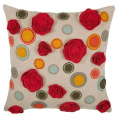 Decorative pillow with an embroidered and applique floral motif.  Product: PillowConstruction Material: Cotton