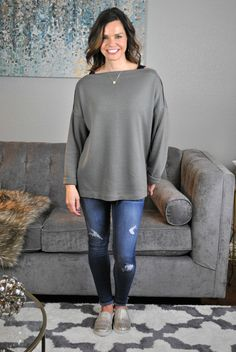 Spring transition outfit! Olive tunic, distressed jeans and gold slip on sneakers. LOVE!!!