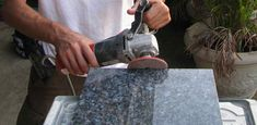 Polishing edges of granite tile with a stone polisher.