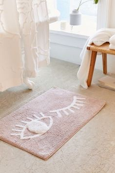 Shop Winky Eye Bath Mat at Urban Outfitters today.
