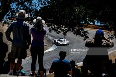 Fans watch the #5 Corvette DP of Joao Barbosa and Christian Fittipaldi as it races through the corkscrew during the IMSA WeatherTech Series race at Mazda Raceway Laguna Seca on May 1, 2016 in Monterey, California.