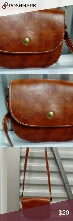 "SALE!! nice leather upper small saddle/xbody bag NWOT really nice leather upper small saddle bag w/very small cut which came w it ""15*5*2"" Bags Crossbody Bags"