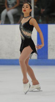 Sk8 Gr8 Designs black custom figure skating dress with lots of Swarovski rhinestones. Learn more about custom dresses at http://sk8gr8designs.com