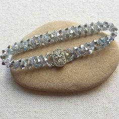 OMG! This is gorgeous.  and EASY!!  Right Angle Weave (RAW) embellished crystal bracelet tutorial.